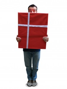 man holding a large birthday gift